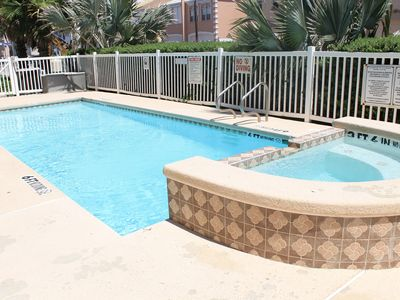 Photo for Steps from pool & across street from beach!