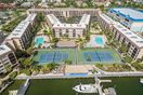Bird's eye view of Anglers Cove and its amenities: tennis courts, pools, hot tubs, tiki bar & restaurant and boat docks