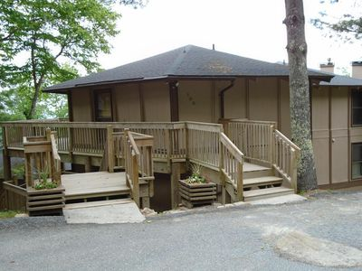 Park next to the steps. DOWN will lead to patio and grille. UP leads to condo.