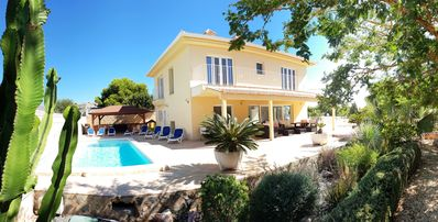 Photo for Comtemporary detached villa with air-co. Wifi, pool and sea-views.