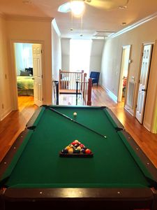 8ft Slate Pool table in hall outside of the media room.