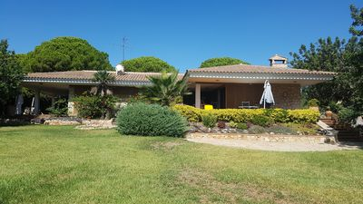 Photo for Villa with extensive plot and garden. Direct access to semi private beach.
