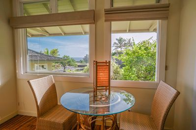 Enjoy your morning coffee  while planning a day in Kauai with this ocean view!