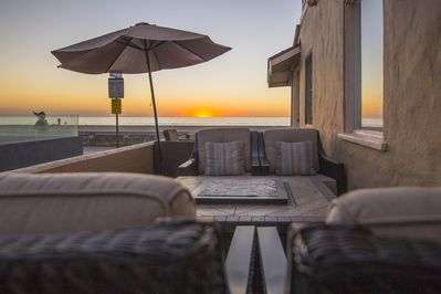 Beautiful sunsets on the deck looking out at the ocean from the fire pit.