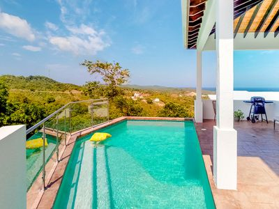 Photo for Hillside home w/ private pool overlooking the Caribbean Sea & jungle!