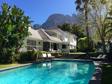 Family House sleeps 9 with large Heated Pool, Tennis Court and Mountain views.