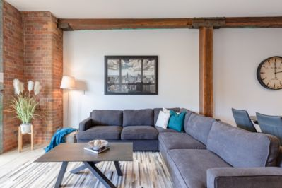 Family size lounge with sofa bed. History and character throughout the apartment