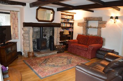 Lounge with woodburner stove and TV