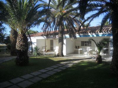 Photo for Holiday villa with lagoon, dune views, sleeps 8, large private garden.