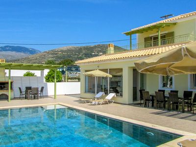 Photo for 4 bed 4 bath villa w/private pool, walking distance to Turtle Beach, free A/C & WiFi.