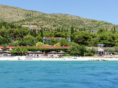 Photo for Just apartment with air conditioning, WiFi and directly on the sea, near Trogir (4 km)
