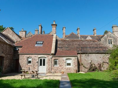 Photo for A ground floor converted building, beautifully restored with its own private south facing courtyard