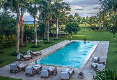 Pool patio at sunset with views of 18th hole fairway and crystal blue Caribbean