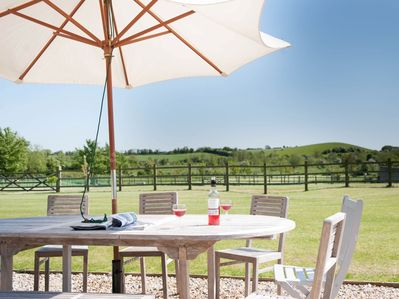 Take in the lovely views across the lawn from the patio area