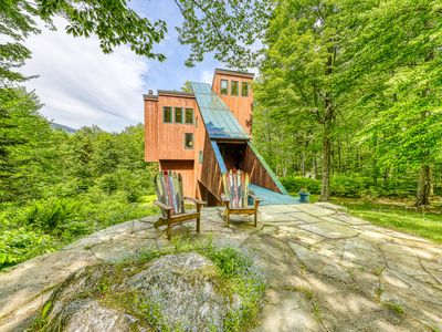 Ski home in the woods w/ a private hot tub, fireplace, & mountain views