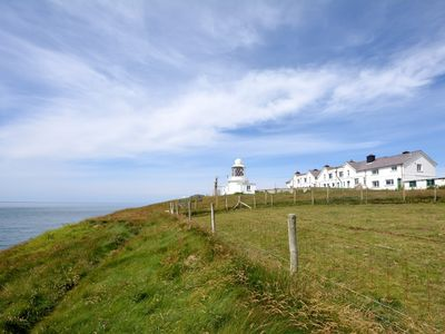 Stunning coastal location for this super mid terrace cottage