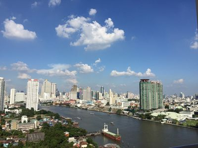 Photo for HI-RISE, 1BR 52sq.m. Serene, Amazing River view, 75/30MbpsWIFI, near ICON SIAM