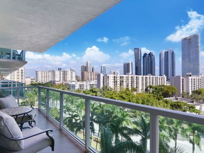 Photo for Spacious condo furnished with custom interiors with a sparkling waterfront pool