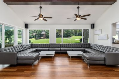 Custom leather sofa that seats up to 20 guests in this living room.High ceilings