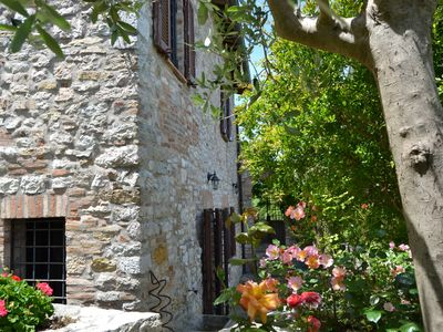 Photo for Ancient rock house with garden,situated in the centre,with view of Umbria