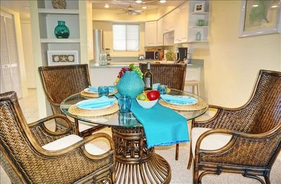 Photo for JANUARY SPECIAL  $1200/WEEK PLUS FEES   APRIL 16TH - 30TH  1700/WEEK PLUS FEES  TROPICAL BREEZES ON WHITE SANDY BEACHES  UNIT 249         2 BD X 2 BA CONDO UPDATED WITH A CANAL VIEW.