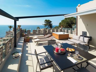 Photo for A stunning terrace with jacuzzi by the sea, and close to the center and beach