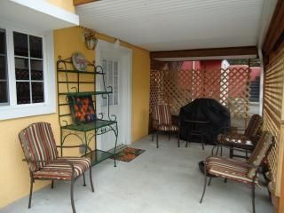 Cozy patio with gas barbeque for summer fun and entertainment.