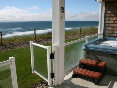 Photo for Upscale Oceanfront condo with private patio & hot tub.