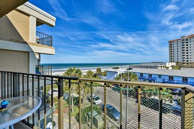 Enjoy ocean views from the balcony of this vacation rental!