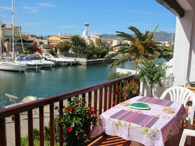 Photo for beachfront apartment, overlooking the canal and port Empuria, quiet area.