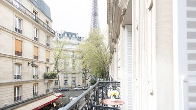 The charming balcony looks out onto beautiful Eiffel Tower views