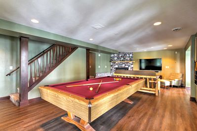 A pool table, dartboard, boat dock and fire pit are sure to keep you entertained