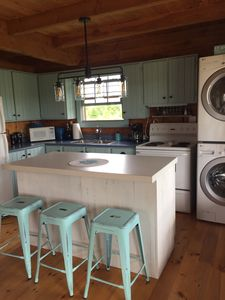 Bright updated kitchen with full laundry
