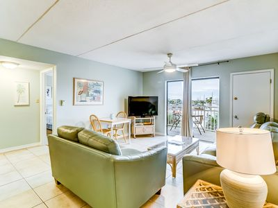 Photo for Beach view condo w/ a spacious living area, shared pools, & tennis courts!