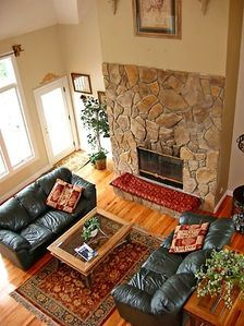 Great Room with 30 foot cathedral ceilings and stone wood burning fireplace.
