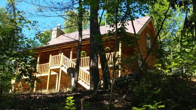 Photo for FREEnite w/ 3 OCT Huge 3 story Log  Home LAKE,BEACH,RIVER,waterfall,pets, Snoski