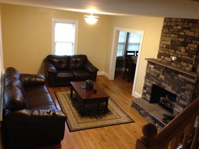 Living Room with leather Sleeper Sofa and beautiful stone gas fireplace