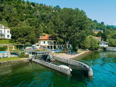 Photo for On the shores of Lake Maggiore, swimpool, beach and balcony with lake view