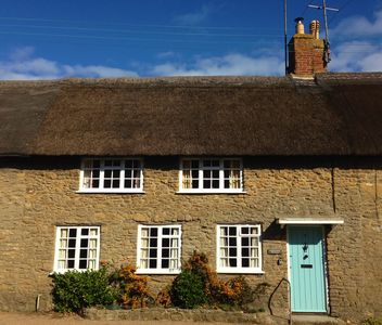 Photo for Listed Thatched Cottage In Burton Bradstock