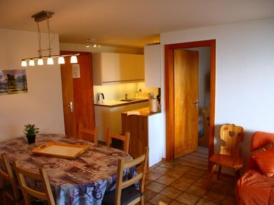 Photo for 3***, 2-bedroom-apartment for 6 people next to the cable car. Bright living room with fireplace, TV
