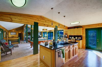 Kitchen view can also see pool table and great room living area