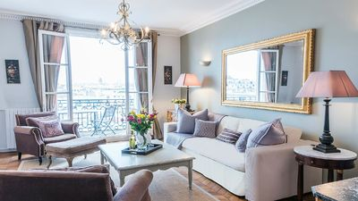 French doors in the living room open to balcony