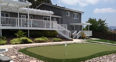 Putting Green and a huge deck are just PART of an amazing and private backyard