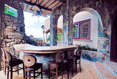 Bar cave with tv, MP3 connectivity, frig, sink, shower, & views.