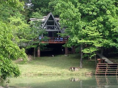 View of the chalet and dock from the water.