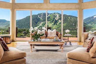 View from double height living room ceilings to Aspen Mountain and beyond.