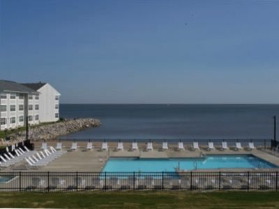 Enjoy the beautiful view of Lake Erie as you relax by the pool.