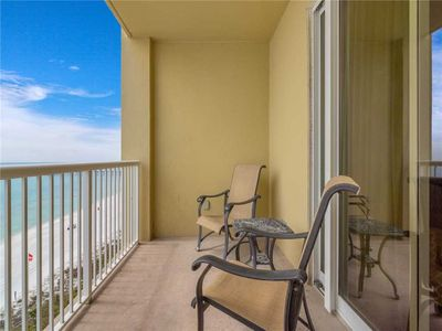 Relax and Enjoy the View – The covered balcony's comfortable furniture and beautiful Gulf view invite you to linger.