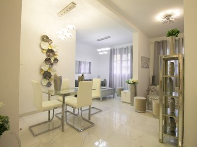 Photo for Elegant apartment with marble floors and an open-plan layout on a residential street. FRG2