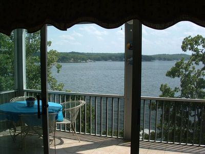 Large screened balcony on the lake. Also has a rocking chair and porch swing.